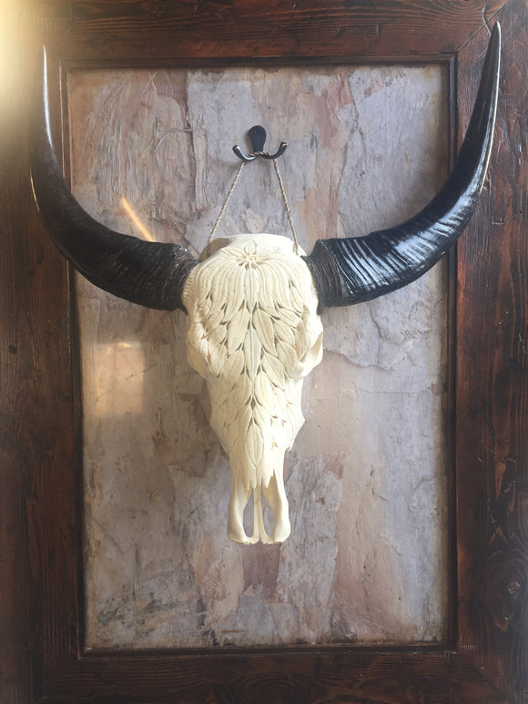 18. Carved Buffalo Skull with Feather Design