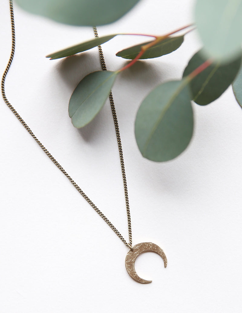 Dainty brass moon necklace hand made by jewelry designers, Cival Collective, from the USA..