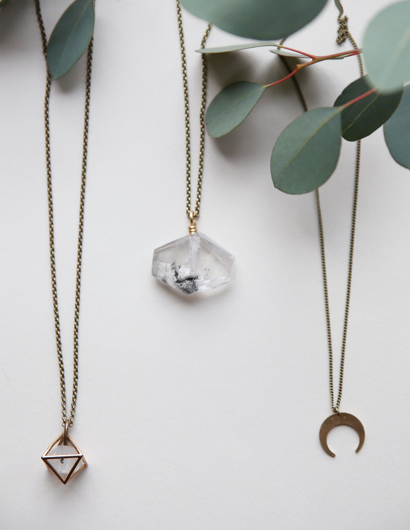 collection of brass moon and gemstone necklaces handmade by Midwest jewelry designers, Cival Collective.