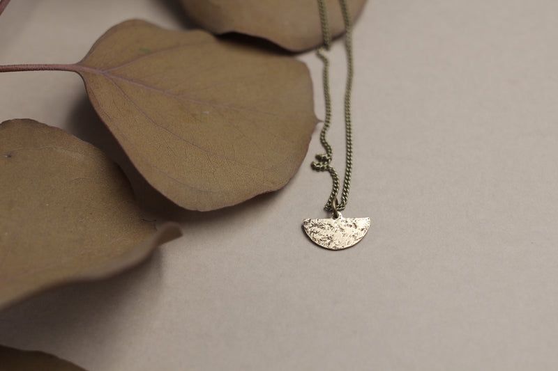 Dainty moon necklace handmade by Milwaukee jewelry designers, Cival Collective.