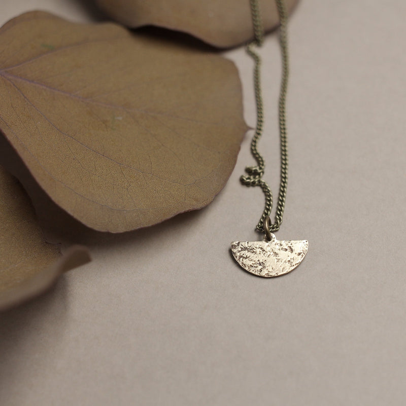 Textured brass necklace for the modern trendy woman, hand made in Milwaukee WI by jewelry designers at Cival Collective.