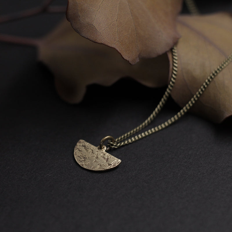 Tiny brass blade necklace made by Wisconsin jewelry designers, Cival Collective.