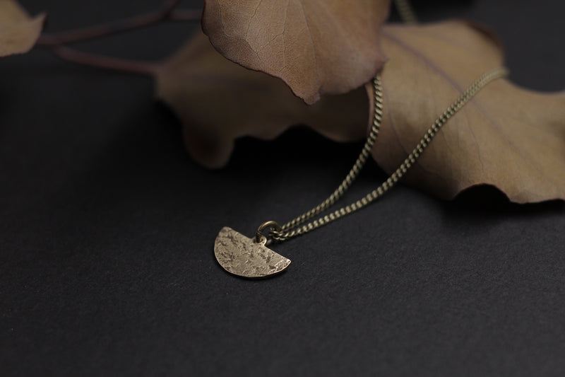 Delicate brass moon necklace handmade by Milwaukee jewelry designers, Cival Collective.
