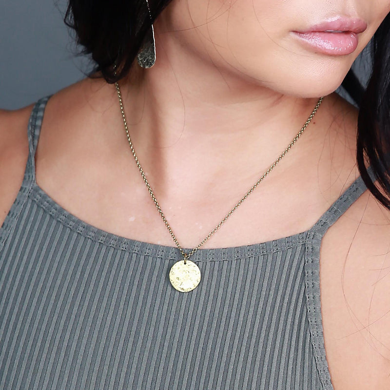 Delicate brass necklace handmade by jewelry designers, Cival Collective.