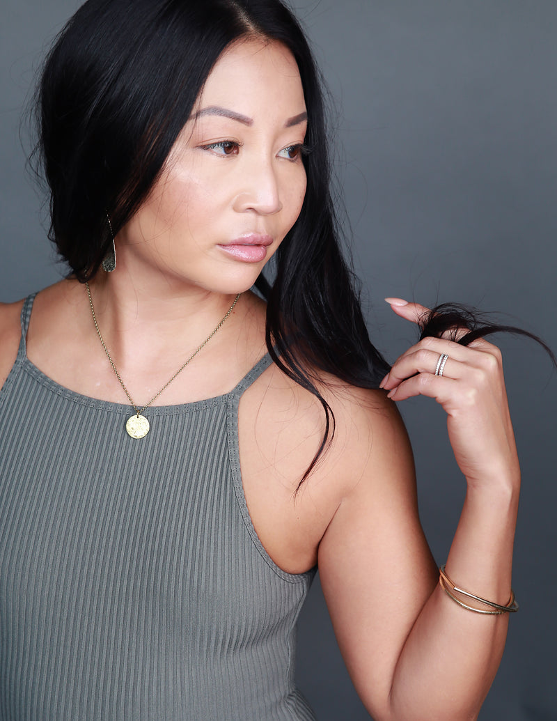 Model wearing classic necklace handmade by local Milwaukee jewelry designers, Cival Collective.