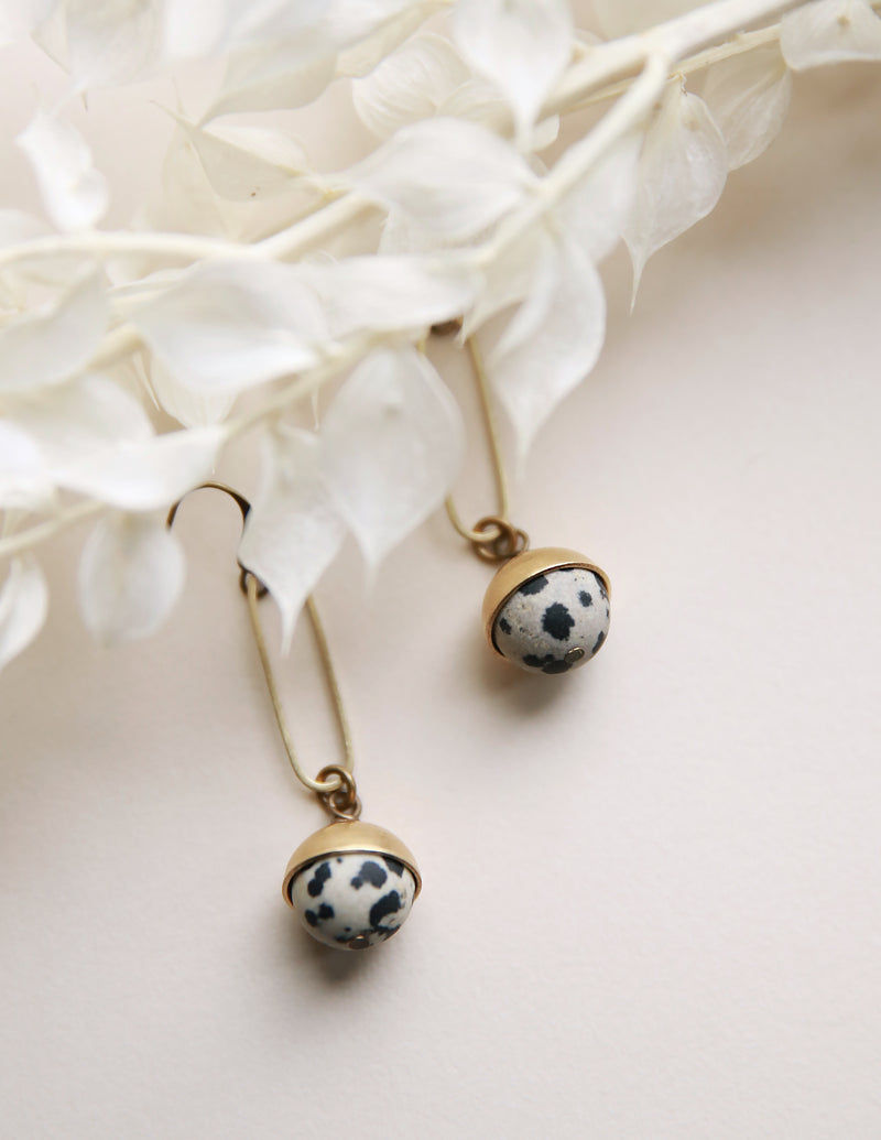 Dalmatian Jasper and brass earrings crafted by local Milwaukee Jewelry Designers, Cival Collective.