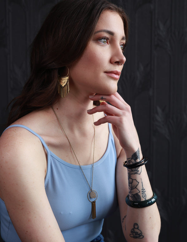Woman modeling Cival Collective jewelry designs at their showroom in Milwaukee, WI.