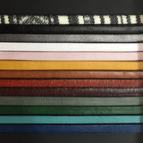 "13 strips of different colored leather to display the options used to make the ""Aster"" leather bracelet."
