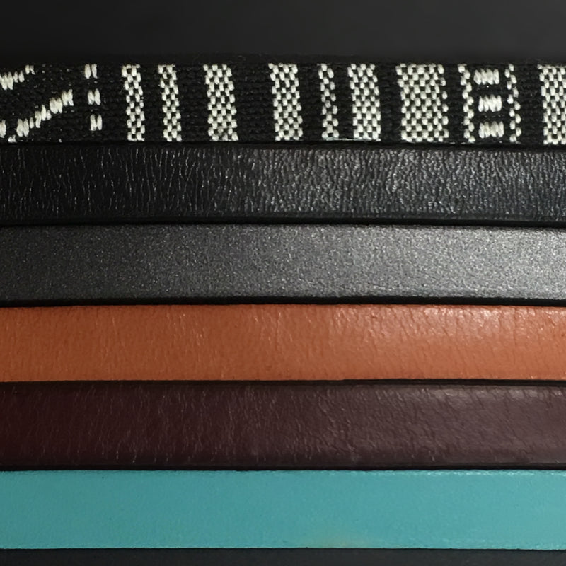 """Acer"" wide double wrap bracelet color options: Black & White fabric, black leather, gunmetal leather, tan leather, mahogany leather, and turquoise leather."