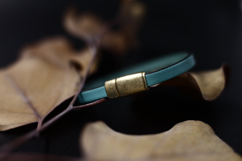 "Close up of magnetic brass clasp on the ""Aster"" turquoise leather bracelet by CIVAL Collective."