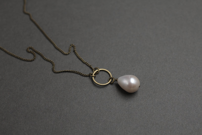 Cival Jewelry designs bridal collection featuring natural pearls and antique brass chain.