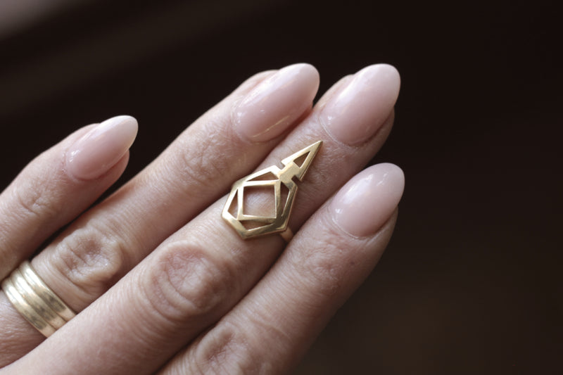 Geometric midi ring in brass or silver, designed to open metal drink tabs to save your hands and nails. Milwaukee studio and boutique making custom set precious and fine jewelry designs in Walkers Point.
