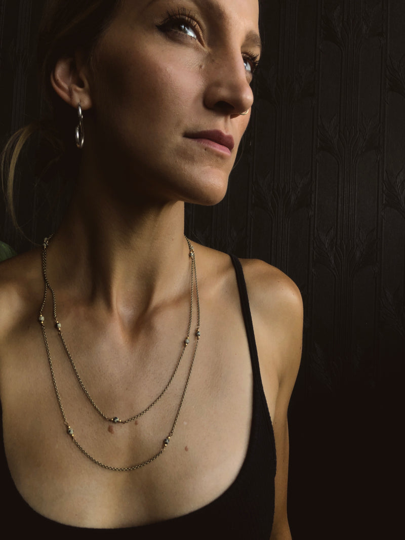 """Janet"" Dalmatian jasper necklace. Pictured on model from CIVAL Collective in Milwaukee WI."