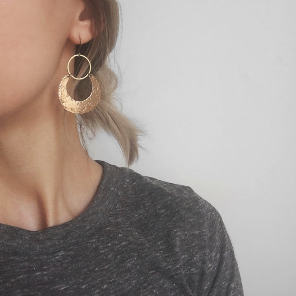 "Cival's ""Lana"" hand textured brass crescent moon & open circle earrings worn on model."