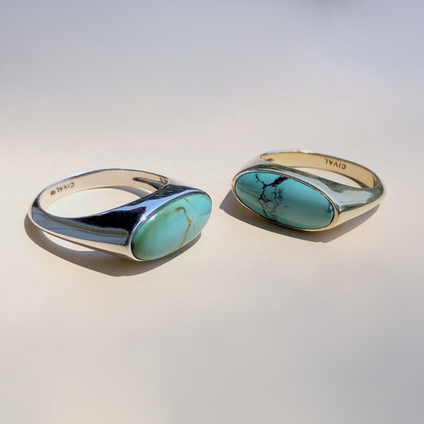 Natural Turquoise and sterling silver signet style ring with east west setting by Cival Collective.