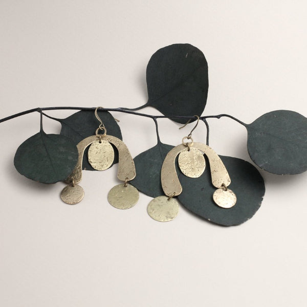 Asymmetrical textured brass collage earrings with multiple circles & organic curvy shapes.