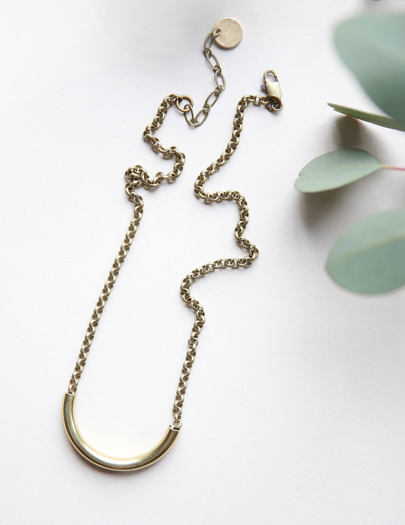 Brass tube necklace handmade by local Milwaukee Jewelry Designers, Cival Collective.