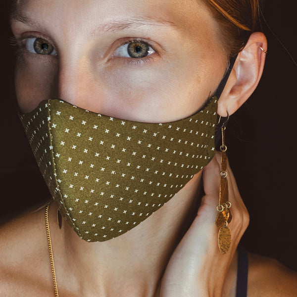 Model wearing Cival Face Mask in Olive, size small