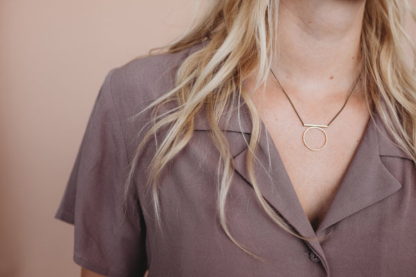 delicate soldered brass ring necklace hand made in the Midwest, Milwaukee WI, by Cival Collective.