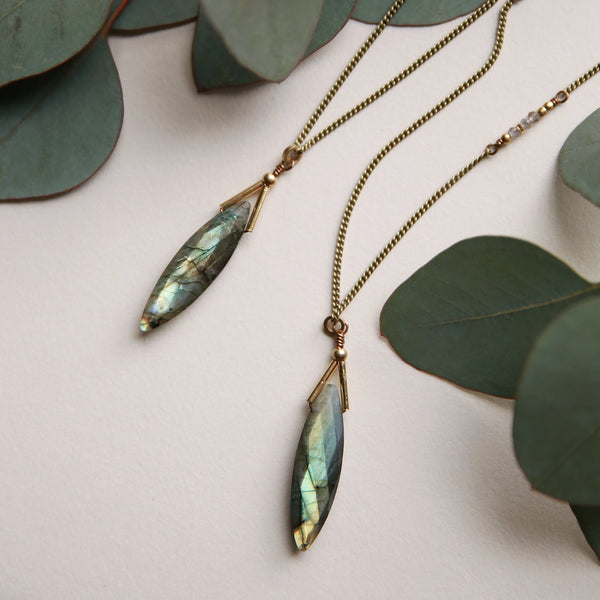Stunning faceted labradorite pendant meticulously crafted with clean sophistication in mind by local Milwaukee jewelry designers, Cival Collective.
