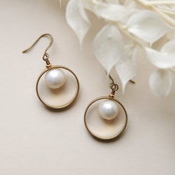 Classic pearl earrings by Cival collective with brass halo ring. Simple wedding jewelry designs that make the perfect gifts for bridesmaids. American handmade designs are crafted in our retail jewelry store and studio in Milwaukee WI.