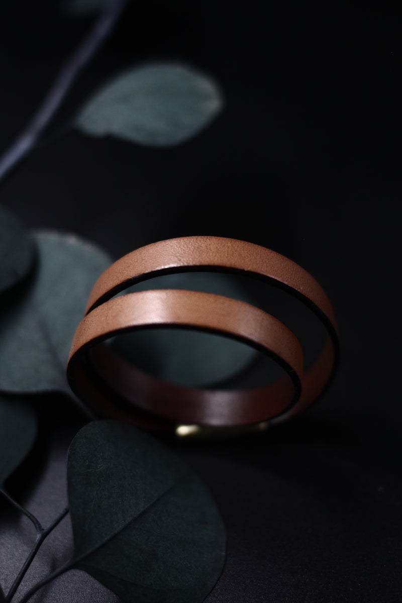 "CIVAL Collective's ""Acer"" 10mm wide tan leather bracelet, double wrapped and closed with magnetic clasp, displayed on black background."
