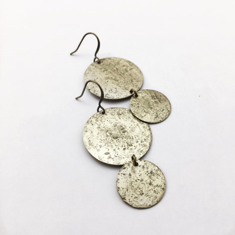 hand textured bright brass round earrings hand made in the Midwest, Milwaukee WI, by Cival Collective.