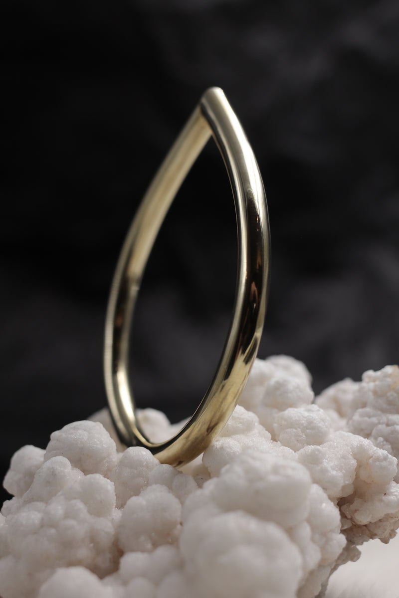 Solid brass teardrop bracelet, $72 (7mm thick). Made in Milwaukee, WI by CIVAL Collective.