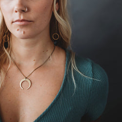 textured brass open moon necklace made by hand in Milwaukee Wisconsin by local jewelry designers Cival Collective.