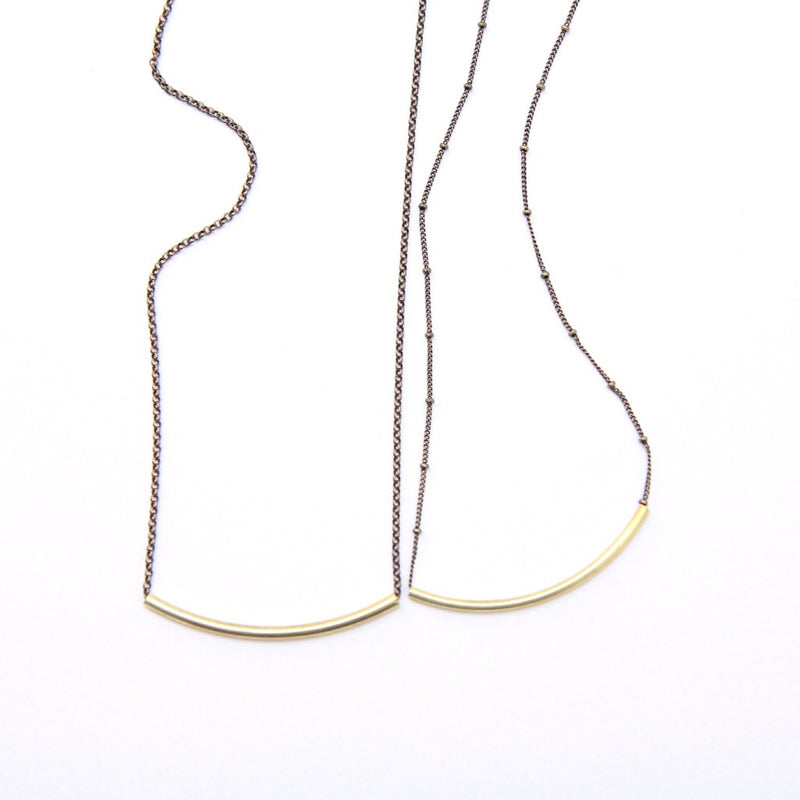 "Two ""London"" 2 inch brass arc slide necklaces, one on rolo chain and one on satellite chain made by CIVAL Collective."