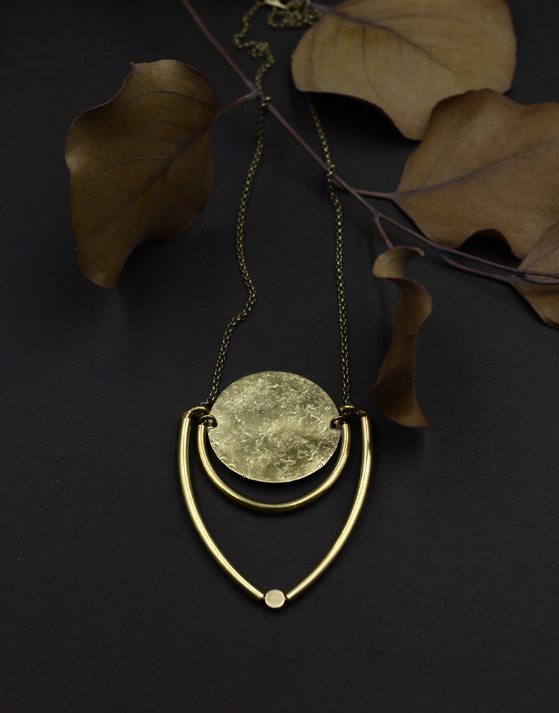 Brass shield necklace handmade in the Chicago vicinity by local Milwaukee designers Cival Collective.