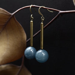 Blue angelite gem stone and brass earrings made by hand in Milwaukee Wisconsin by local jewelry designers Cival Collective.