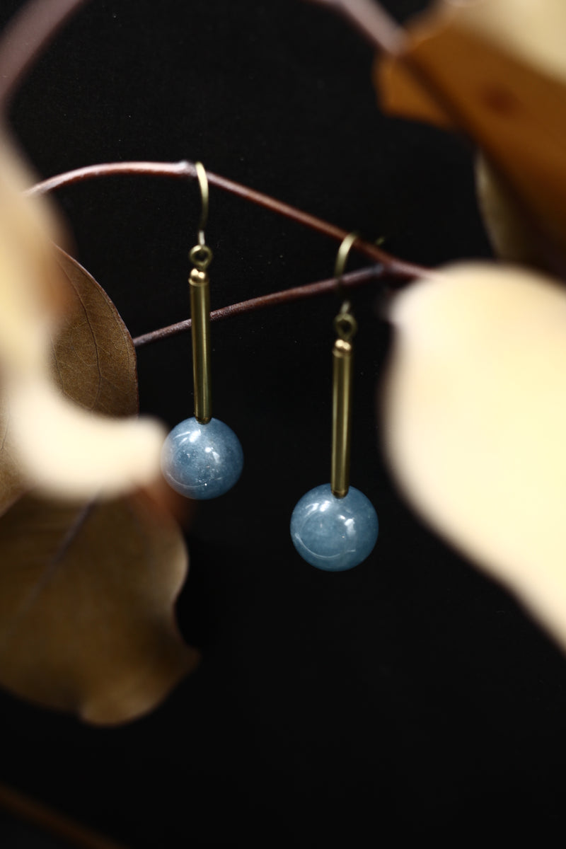Blue angelite gem stone and brass earrings made by hand in the Midwest by local jewelry designers Cival Collective.