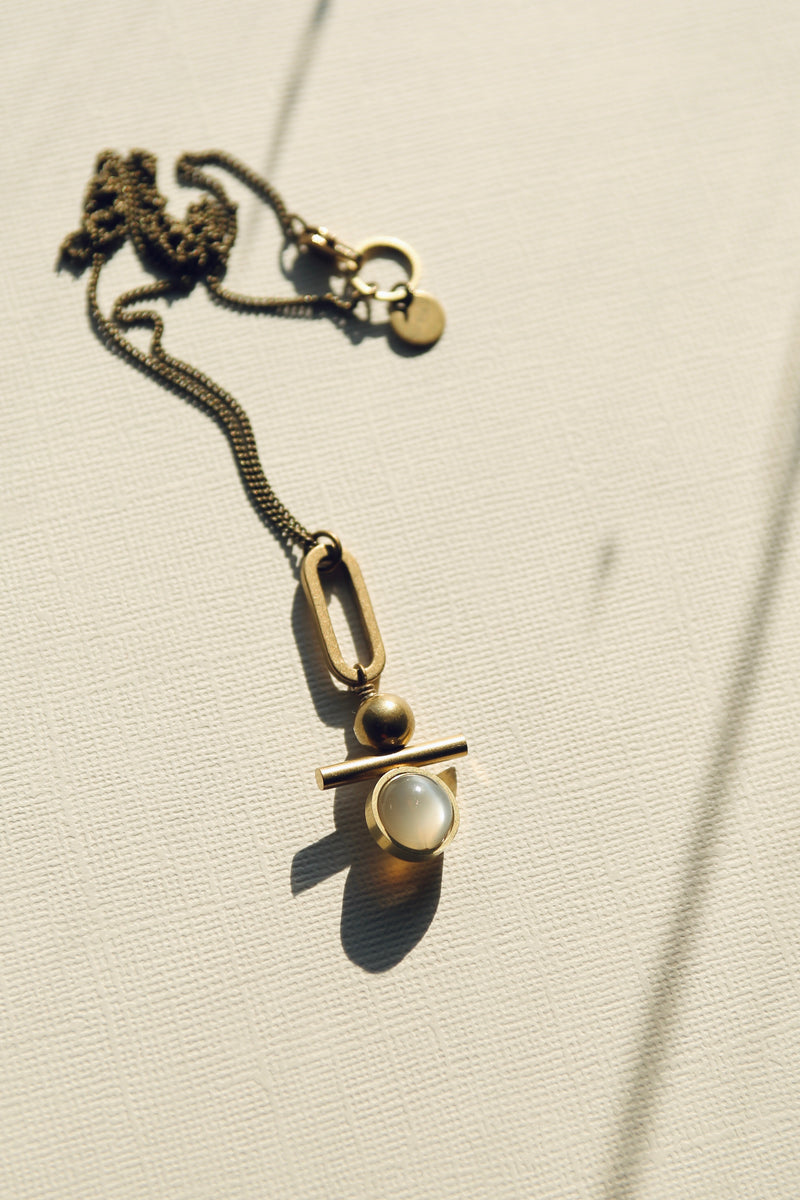 """Mave"" light gray moonstone & brass pendant necklace made by CIVAL Collective in Milwaukee WI."