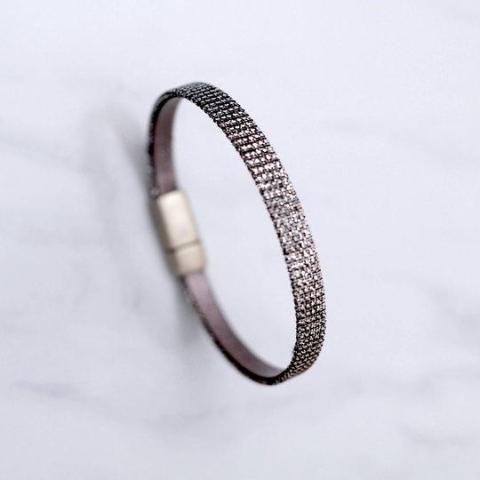 "Close up of the ""Mica"" shimmer woven fabric & leather bracelet with magnetic clasp made by Cival Collective."