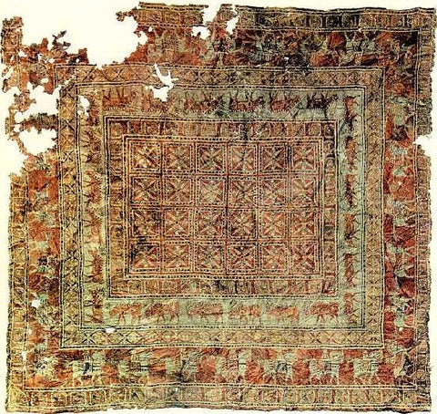 One of the first hand tufted rugs made in Persia.