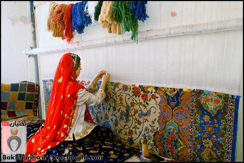 An artisan working on a hand knotted rug