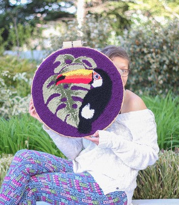 toucan and leaf wall art tufted by andie solar of myra and jean