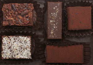 Assortment Our Quintet Box is a great introduction to our Hearts of Chocolate Truffles. It features our 5 signature flavors: almond butter with smoked sea salt, zested lime, mocha cinnamon, crushed cacao nib, and toasted coconut.  5 pieces  2oz.