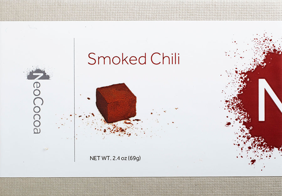 Our dark chocolate smoked chili truffle features a blend of ancho and chipotle chilies for a slightly smoky heat that is sure to kick things up a notch. Bordering on the savory, these truffles are delicious on their own or paired with your favorite bottle of red. 6 pieces  2.4oz.