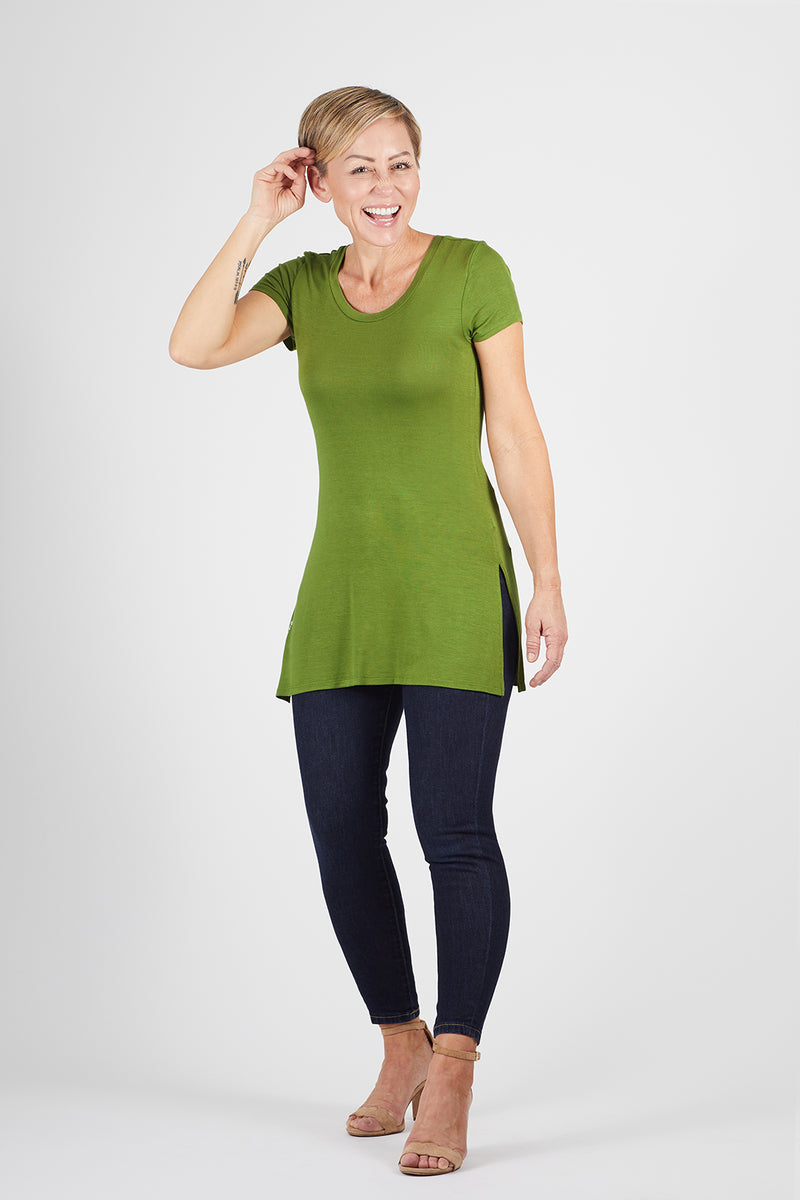 Model wearing the Dawl Tunic in black with the Lumo Legging in green, by illuminative