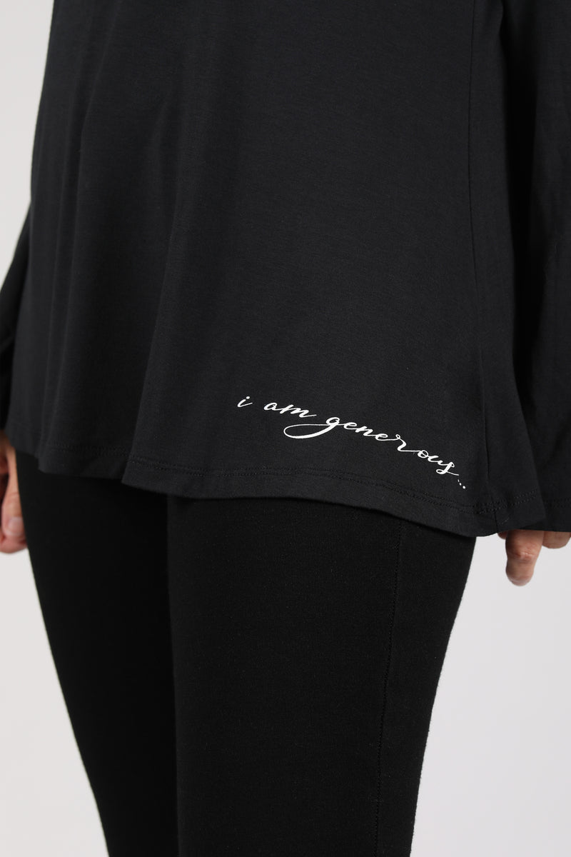 "Detail of the Lumiere Top in black with ""i am generous"" affirmation"