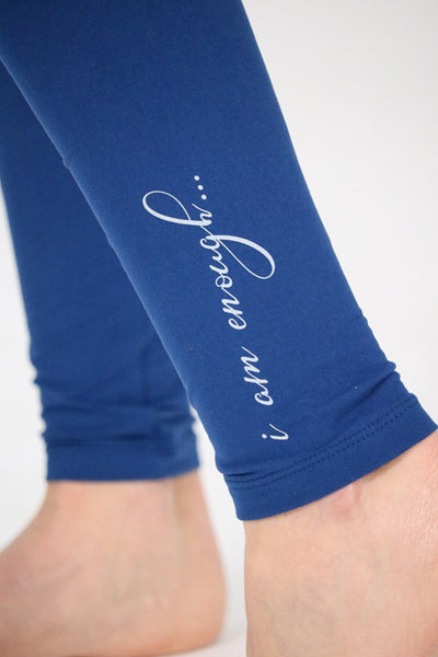 "close up of affirmation printed on the ankle of the leggings: affirmation reads"" I am enough..."""