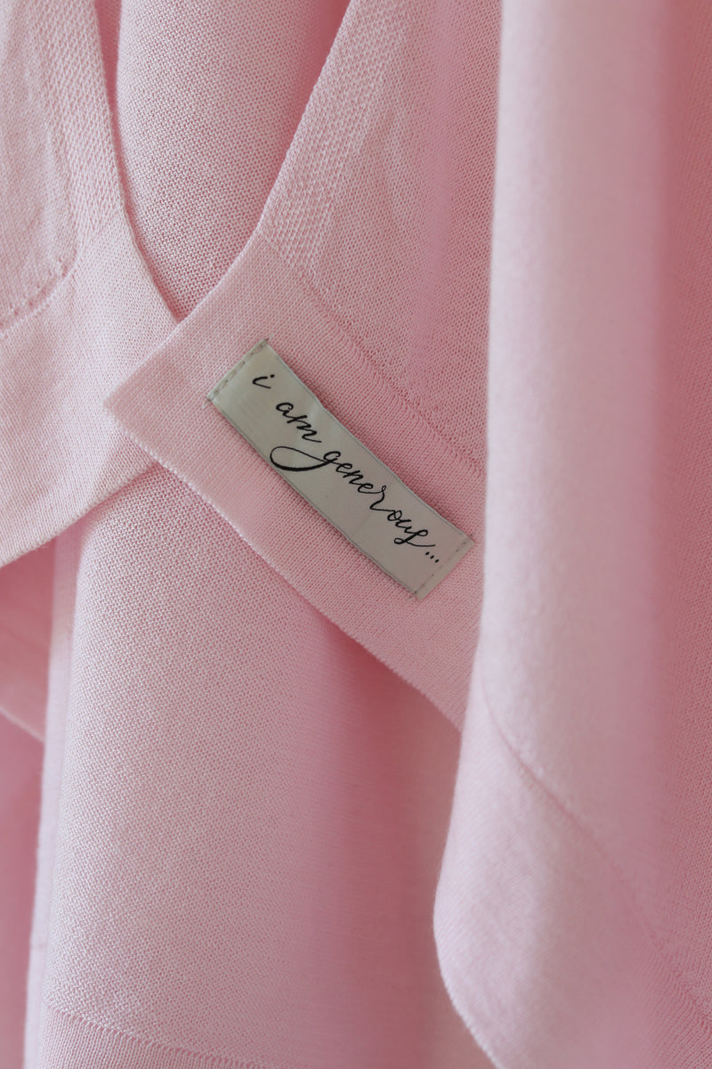 "Detail of the Lux Kimono in Blush by illuminative with ""i am generous"" affirmation on woven label"