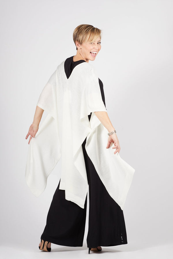 Model wearing the Lux Kimono in white over the Kirigama Jumpsuit, by illuminative