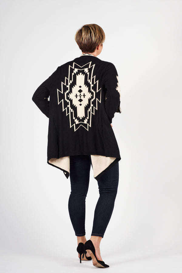back of model showing the geometric print on the back of the Nani Cardigan aka Luxurious Geometric cardigan.