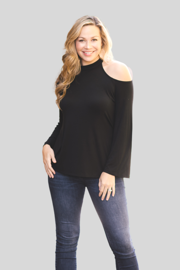 model wearing lumiere top with open shoulders and long sleeves.