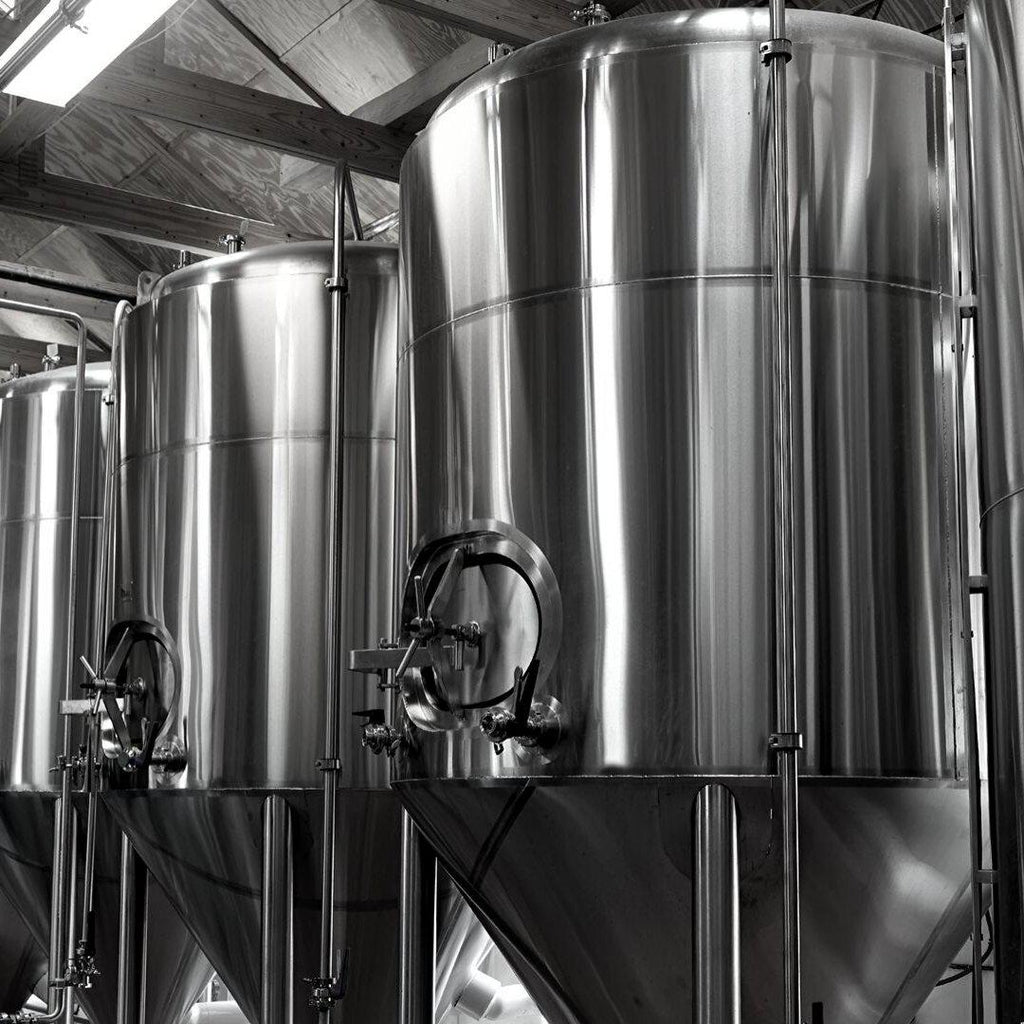 How is beer stabilized in a brewery?