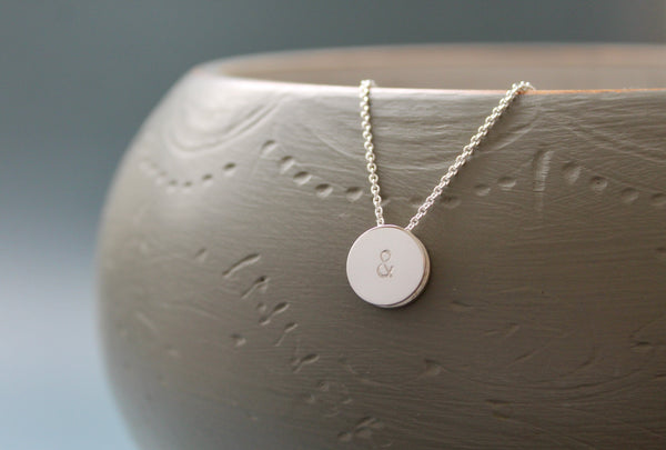 reversible symbol pendant necklace in sterling silver