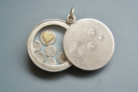 sterling silver floating dandelion locket filled with stamped letter plates